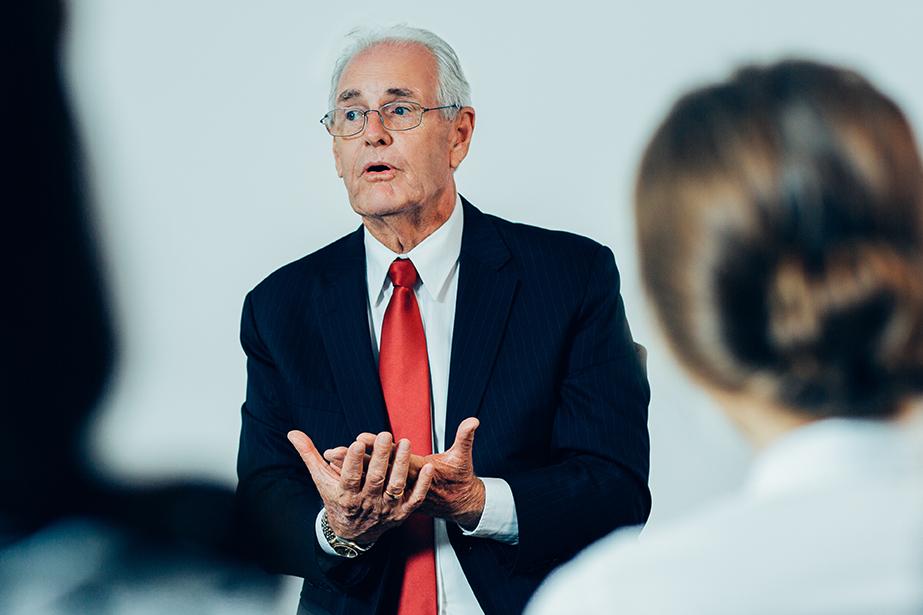 man speaking to group